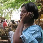 African woman with mobile phone Photo by IICD