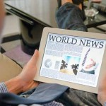 Reading news on a tablet from iStockphoto