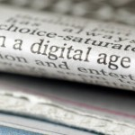 Digital age on newspaper from iStockphoto
