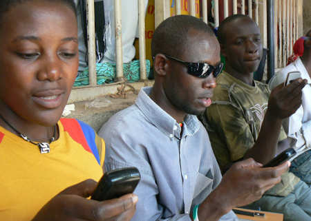 Texting in Uganda by Ken Banks from Flickr